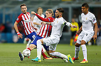Calcio, finale di Champions League: Real Madrid vs Atletico Madrid. Stadio San Siro, Milano, 28 maggio 2016.<br /> Atletico Madrid Fernando Torres, left, and Real Madrid&rsquo;s Sergio Ramos fight for the ball during the the Champions League final match between Real Madrid and Atletico Madrid, at Milan's San Siro stadium, 28 May 2016. At right, Real Madrid&rsquo;s Casemiro.<br /> UPDATE IMAGES PRESS/Isabella Bonotto