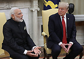 United States President Donald Trump (R) meets with Indian Prime Minister Narendra Modi (L) in the Oval Office of the White House June 26, 2017 in Washington, DC. Trump and Modi are scheduled to deliver joint statements later today following their meetings.<br /> Credit: Win McNamee / Pool via CNP