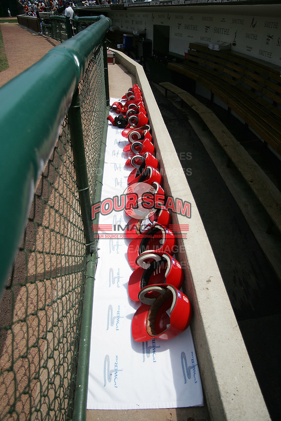 Baseball helmets lined up at Wrigley Field in Chicago. Photo by Andrew Woolley / Four Seam Images.