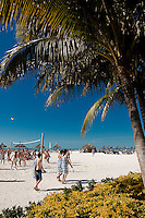 Teens enjoy beachfront activity along Gulf of Mexico on Marco Island, Florida, USA. Photo by Debi PIttman Wilkey