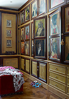 Portraits of dogs dressed as gentlemen are painted on the doors of the dressing room cabinets