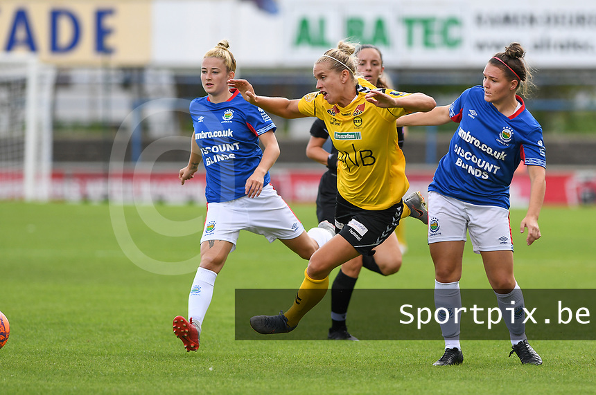 20190807 - DENDERLEEUW, BELGIUM : LSK's Elise Thorsnes pictured being fouled by Linfield's Abbie Magee (right) during the female soccer game between the Norwegian LSK Kvinner Fotballklubb Ladies and the Northern Irish Linfield ladies FC , the first game for both teams in the Uefa Womens Champions League Qualifying round in group 8 , Wednesday 7 th August 2019 at the Van Roy Stadium in Denderleeuw  , Belgium  .  PHOTO SPORTPIX.BE for NTB  | DAVID CATRY