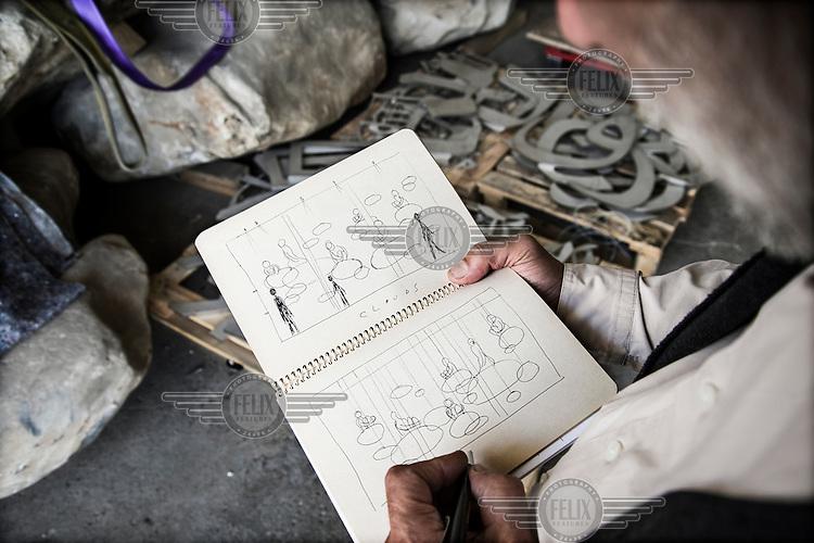 Catalan artist Jaume Plensa sketching some of his works at his huge studio in an industrial area of Sant Feliu de Llobregat.