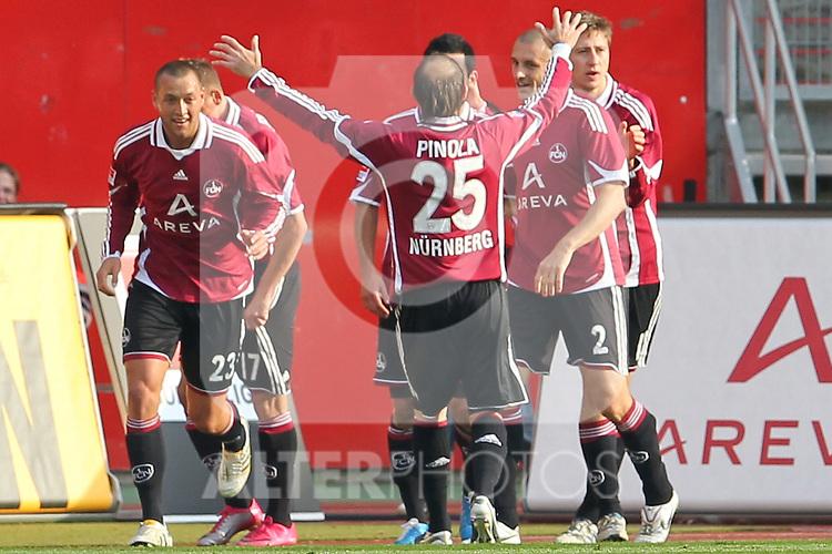 23.10.2010, easyCredit-Stadion, Nuernberg, GER, 1.FBL,  1. FC Nürnberg vs VfL Wolfsburg, im Bild  Javier Pinola (FCN #25), Timmy Simons (FCN #2), Julian Schieber (FCN #23) und Jens Hegeler (FCN #13) jubeln mit dem Torschuetzen Ilkay Guendogan (FCN #22)   Foto © nph / Becher