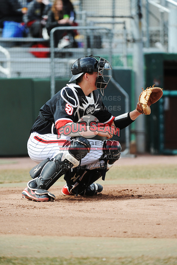 St. John's Redstorm catcher Frank Schwindel (5) during 2nd game of double header against the University of Cincinnati Bearcats at Jack Kaiser Stadium on March 28, 2013 in Queens, New York. Cincinnati defeated St. John's 6-5.      . (Tomasso DeRosa/ Four Seam Images)