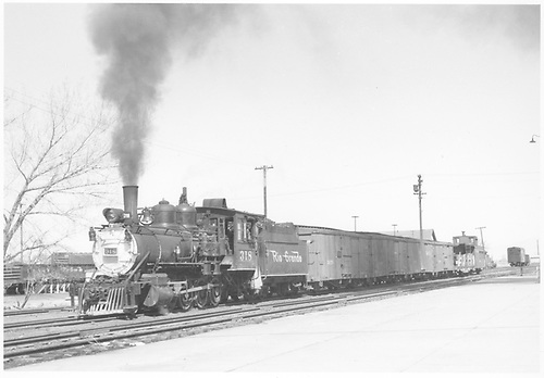 3/4 fireman's-side view of D&amp;RGW #318 with a 6-car freight train departing Montrose for Ouray.<br /> D&amp;RGW  Montrose, CO  Taken by Richardson, Robert W. - 4/21/1952