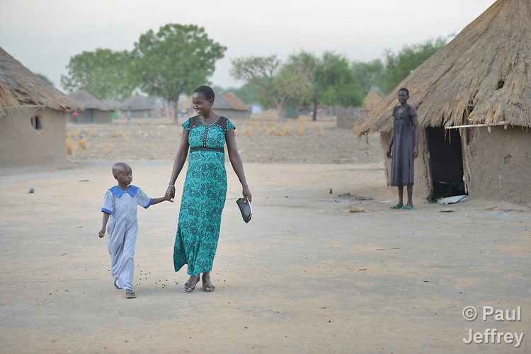 Rebecca Achol Atem walks her 5-year old daughter Saloma Nyandeng to an early childhood development center on April 13, 2017, in Panyagor, a town in South Sudan's Jonglei State. <br /> <br /> The Lutheran World Federation, a member of the ACT Alliance, is helping families in the region, which is torn by both war and drought, to educate their children, with a special focus on insuring that girls enter and remain in school.