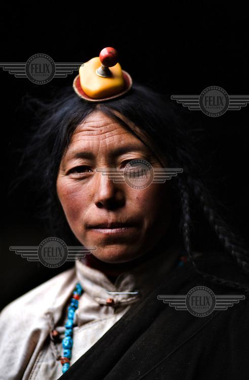 A portrait of a nomadic Khampa woman.