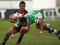 Counties winger Lelia Masaga hands off Lote Raikabula during the Air NZ Cup rugby match between Manawatu Turbos and Counties-Manukau Steelers at FMG Stadium, Palmerston North, New Zealand on Sunday, 2 August 2009. Photo: Dave Lintott / lintottphoto.co.nz