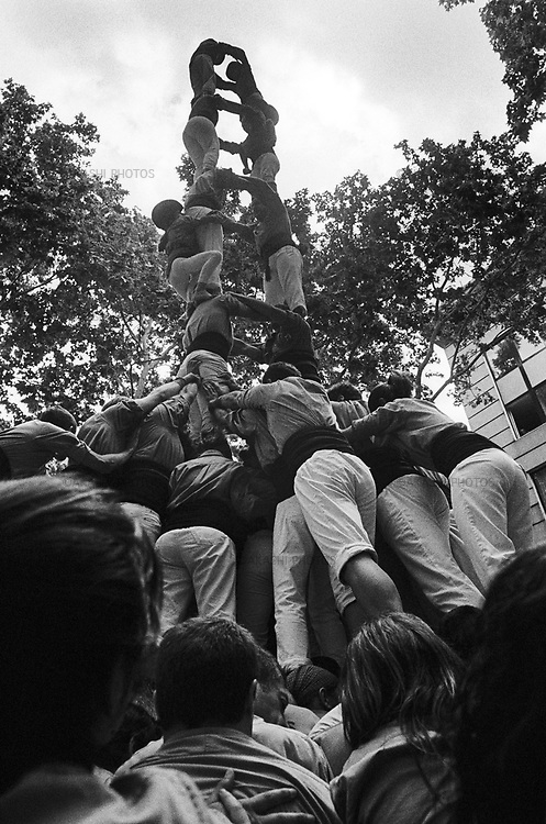 Castallers, human tower, is performed in Sants district, Barcelona, Spain.