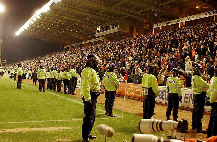 Riot cops at Pittodrie as Rangers visit on 19th Jan 2001.