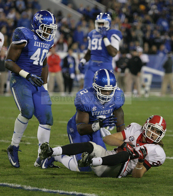 Alvin Dupree tackles Rhett McGowan during the game between the University of Kentucky and the University of Georgia, during homecoming week at Commonwealth Stadium, on Saturday, Oct. 20, 2012. Kentucky lost 24-29. Photo by Latara Appleby | Staff