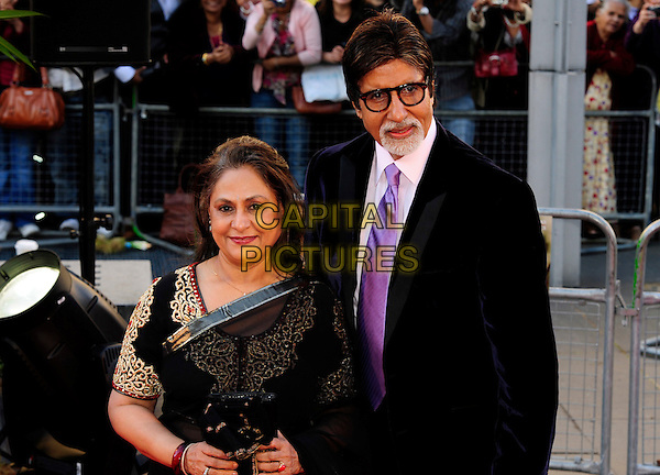"JAYA & AMITABH BACHCHAN.Attending the ""Raavan"" UK film premiere, BFI South Bank, London, England, UK, June 16th 2010..half length glasses purple tie white shirt black glasses jacket suit pink goatee facial hair married husband wife gold sari.CAP/CJ.©Chris Joseph/Capital Pictures."