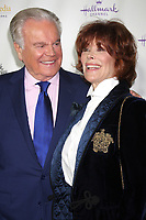 ***FILE PHOTO*** ***Robert Wagner Deemed A Person Of Interest In The Death Of Natalie Wood***LOS ANGELES, CA - NOVEMBER 4: Robert Wagner, Jill St. John at the Hallmark Channel's Northpole Screening Reception at La Piazza Restaurant in Los Angeles, CA on November 4, 2014. <br /> CAP/MPI/DE<br /> &copy;DE/MPI/Capital Pictures