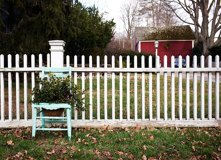 Woodbury, CT- 03 January 2016-010316CM02- COUNTRY LIFE--- A chair and white fence is shown in front of Farmhouse Antiques in Woodbury on Sunday.   Christopher Massa Republican-American