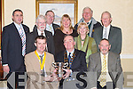 Published Caption: SPECIAL AWARD: Anthony Buckett (President Dingle Rotary Club) presenting the Cecil D Whaley Memorial Trophy to Risteard Pierse (President Tralee Rotary Club) at the Brandon Hotel, Tralee, on Tuesday. The Cecil D Whaley Memorial Trophy is a national award by Rotary Ireland for the most outstanding and innovative clubs. It is presently being shared by the Rotary Clubs of Kerry for their work fundraising for Kerry charities, in particular in relation to the Kerry Christmas Appeal organised in conjunction with Radio Kerry. Front l-r: Risteard Pierse (President Tralee Rotary Club), Anthony Buckett (President Dingle Rotary Club) and Jim Milhench (Past President Dingle Rotary Club). Back were George Phillips (Vice President Tralee Rotary Club), Ray Farrell (Past President Dingle Rotary Club), Hilary Kelly (Asst Governor Rotary Ireland), Kate Campbell (Secretary Tralee Rotary Club), Margaret Healy, Neal Timlin and Paddy OSullivan (Past Presidents Tralee Rotary Club)..