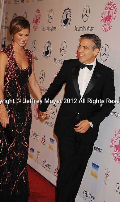 BEVERLY HILLS, CA - OCTOBER 20: George Clooney and Stacy Keibler arrive at the 26th Anniversary Carousel Of Hope Ball presented by Mercedes-Benz at The Beverly Hilton Hotel on October 20, 2012 in Beverly Hills, California.