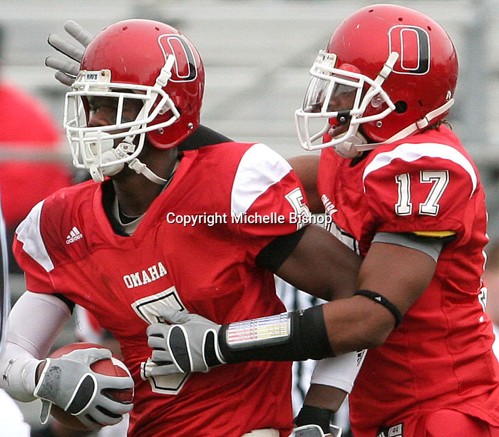 UNO's Bruce Harris (right) celebrates with Matt Ajuoga after Ajuoga's interception in the second quarter of Saturday's game against Central Missouri.