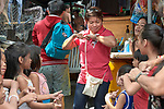 Deaconess Irene Lagahit Vioya sings with a group of children in a poor neighborhood in Manila, Philippines. A graduate of Harris Memorial College, she works on the staff of Knox United Methodist Church.