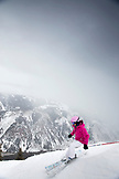USA, Colorado, Aspen, a woman skiis and makes turns at the top of Kessler's run, Aspen Highlands Ski Resort