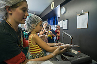 NWA Democrat-Gazette/ANTHONY REYES • @NWATONYR<br /> Shelby Shackelford, left, chocolatier at Kyya Chocolate, helps Raven Carr, 6, make a chocolate bar Thursday, Sept. 24, 2015 at the Kyya chocolate factory in Elm Springs. Raven and other students fromthe NWA Social Homeschoolers got a tour of the facility. The students learned how they make chocolate, where the company gets their coco beans from and they got to make a bar of milk chocolate themselves.