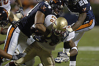 24 September 2005:  Virginia's Ahmad Brooks (34) tackles Lorenzo Booker (28).  The Virginia Cavaliers upset the #4 Florida State Seminoles 26-21 at Scott Stadium in Charlottesville, VA.