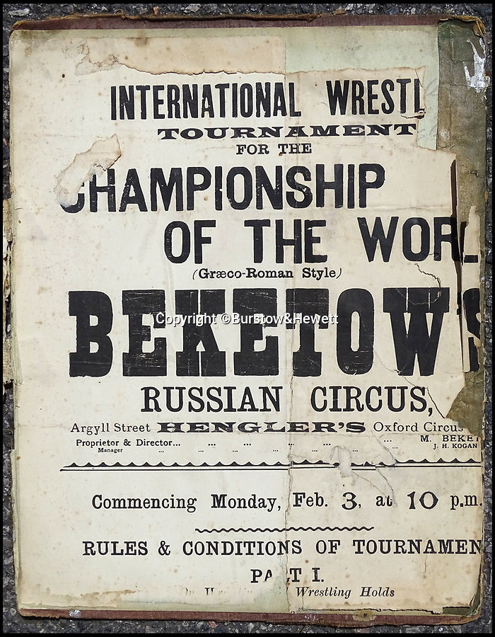 BNPS.co.uk (01202 558833)Pic: Burstow&Hewett/BNPS<br /> <br /> Early 20th century International Wrestling Tournament poster.<br /> <br /> These are the weird and wonderful performers who entertained Brits during the heyday of the travelling circus in the early 20th century.<br /> <br /> Today some of the acts would be seen as highly insensitive, but back then parading people who were different to the norm on stage was seen as harmless fun.<br /> <br /> One performer made a name for himself hanging a heavy case from his eyelids, while another caused wonderment by balancing five sharp knives on his face and a fearless showman smoked a cigarette through his eye ball. <br /> <br /> Other acts which enchanted British audiences were the 7ft tall German sisters, the world's shortest man who was billed at a mere 2ft 6ins and the very politically incorrectly titled curvaceous French lady 'Reine de Colosses' (collosal queen).