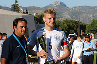 Joe Worrall proudly holds the Trophy for being the second best player of the Tournament during England Under-18 vs Ivory Coast Under-20, Toulon Tournament Final Football at Stade de Lattre-de-Tassigny on 10th June 2017
