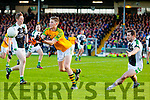Aidan Walsh South Kerry in action against Donal Lyne and Damien O'Sullivan Legion at the Kerry County Senior Football Final at Fitzgerald Stadium on Sunday.