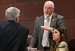 Nevada Assembly Republicans, from left, Erven Nelson, Randy Kirner and Victoria Seaman talk before a committee hearing at the Legislative Building in Carson City, Nev., on Wednesday, April 8, 2015. <br /> Photo by Cathleen Allison