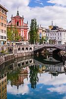 Ljubljana triple bridge (Tromostovje) and the Franciscan Church of the Annunciation reflected in Ljubljanica River, Ljubljana, Slovenia, Europe