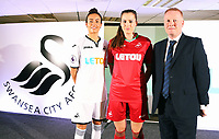 Pictured: Katy Hosford (RED) and Alicia Powe (WHITE) of the Swansea City FC Ladies' team model the home and away kits with Dsability Sport Wales representative. Monday 19 June 2017<br /> Re: Swansea City FC launch their new home and away kits and announce Letou as their new sponsor at the Liberty Stadium, Swansea, Wales, UK.