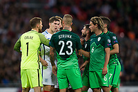 England's John Stones gets involved in a melee <br /> <br /> Photographer Craig Mercer/CameraSport<br /> <br /> FIFA World Cup Qualifying - European Region - Group F - England v Solvenia - Thursday 5th October 2017 - Wembley Stadium - London<br /> <br /> World Copyright &copy; 2017 CameraSport. All rights reserved. 43 Linden Ave. Countesthorpe. Leicester. England. LE8 5PG - Tel: +44 (0) 116 277 4147 - admin@camerasport.com - www.camerasport.com