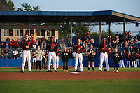 "Batavia Muckdogs Sean Reynolds (15), Demetrius Sims (55), Denis Karas (25), and Marcos Rivera (8) stand with the ""Stars of the Game"" during the national anthem before a game against the Auburn Doubledays on August 26, 2017 at Dwyer Stadium in Batavia, New York.  Batavia defeated Auburn 5-4.  (Mike Janes/Four Seam Images)"