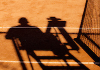 03-09-13,Netherlands, Alphen aan den Rijn,  TEAN, Tennis, Tean International Tennis Tournament 2013, Tean International ,   Shadow of Umpire and net on claycourt<br /> Photo: Henk Koster