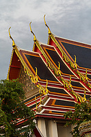 Bangkok, Thailand.  Architectural Detail (chofa, the curling, pointed extensions at each end that represent the Garuda, the vehicle of Vishnu)  on the Wat Pho Temple Housing the Reclining Buddha.