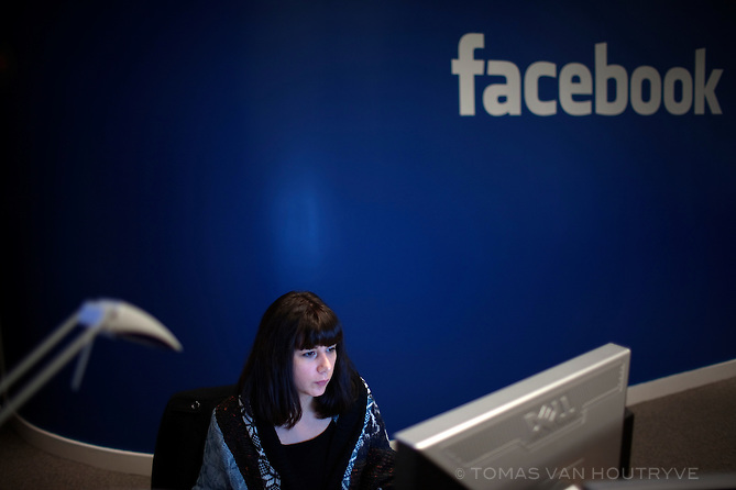 An employees works at a computer inside the offices of Facebook in Paris, France on Nov. 29, 2010.