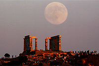 A full moon, known as Sturgeon Moon, rises over the temple of Poseidon in Sounion near Athens,  Greece. Monday 07 August 2017