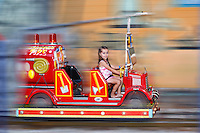 A pretty little girl having fun with fire truck