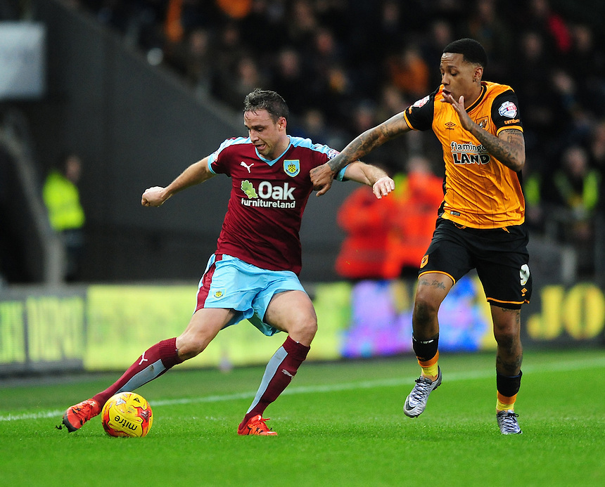 Burnley's Michael Duff vies for possession with Hull City's Abel Hernandez<br /> <br /> Photographer Chris Vaughan/CameraSport<br /> <br /> Football - The Football League Sky Bet Championship - Hull City v Burnley - Saturday 26th December 2015 - Kingston Communications Stadium - Hull<br /> <br /> &copy; CameraSport - 43 Linden Ave. Countesthorpe. Leicester. England. LE8 5PG - Tel: +44 (0) 116 277 4147 - admin@camerasport.com - www.camerasport.com