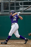 Washington Huskies first baseman Trevor Mitsui (20) follows through on his swing during the NCAA baseball game against the Michigan Wolverines on February 16, 2014 at Bobcat Ballpark in San Marcos, Texas. The game went eight innings, before travel curfew ended the contest in a 7-7 tie. (Andrew Woolley/Four Seam Images)