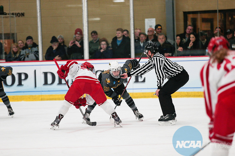 ADRIAN, MI - MARCH 18: Kristin Lewicki (25) of Adrian College watches the puck during a face off at The Division III Women's Ice Hockey Championship held at Arrington Ice Arena on March 19, 2017 in Adrian, Michigan. Plattsburgh State defeated Adrian 4-3 in overtime to repeat as national champions for the fourth consecutive year. by Tony Ding/NCAA Photos via Getty Images)