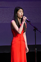 NWA Democrat-Gazette/BEN GOFF @NWABENGOFF<br /> Lou Siyu sings a rendition of 'Time to Say Goodbye' in English and Chinese Saturday, Feb. 10, 2018, during the Chinese New Year Gala presented by the Chinese Association of Northwest Arkansas at Springdale Har-Ber High. The event celebrated the Year of the Dog with a dinner and a show featuring traditional and contemporary Chinese dance, music, fashion and more.