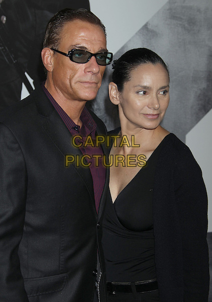 Jean-Claude Van Damme and Gladys Portugues.'The Expendables 2' premiere held at The Grauman's Chinese Theatre, Hollywood, California, USA..15th August 2012.half length cardigan top married husband wife black suit purple shirt sunglasses shades .CAP/ADM/RE.©Russ Elliot/AdMedia/Capital Pictures.