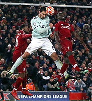 Bayern Munich's Mats Hummels wins an aerial ball despite the attentions of Liverpool's Sadio Mane<br /> <br /> Photographer Rich Linley/CameraSport<br /> <br /> UEFA Champions League Round of 16 First Leg - Liverpool and Bayern Munich - Tuesday 19th February 2019 - Anfield - Liverpool<br />  <br /> World Copyright © 2018 CameraSport. All rights reserved. 43 Linden Ave. Countesthorpe. Leicester. England. LE8 5PG - Tel: +44 (0) 116 277 4147 - admin@camerasport.com - www.camerasport.com