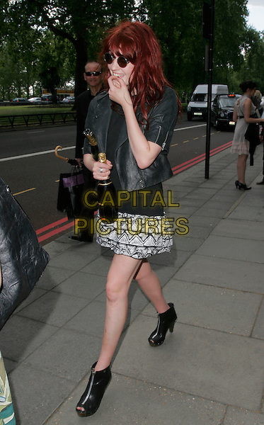 FLORENCE WELCH - Florence & The Machine .Leaving the 54th Ivor Novello awards at the Grosvenor House Hotel, London, England. .May 21st, 2009 .full length jacket black white pattern skirt hand bottle champagne open boots sunglasses shades .CAP/AH.©Adam Houghton/Capital Pictures.