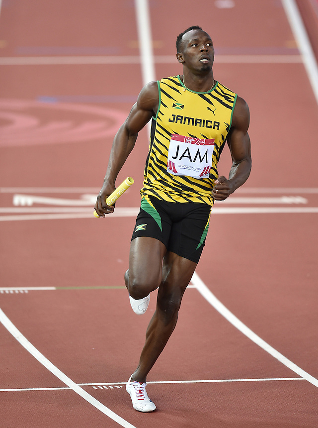Jamaica's Usain Bolt during the men's 4x100m relay heat 2<br /> <br /> Photographer Chris Vaughan/CameraSport<br /> <br /> 20th Commonwealth Games - Day 9 - Friday 1st August 2014 - Athletics - Hampden Park - Glasgow - UK<br /> <br /> &copy; CameraSport - 43 Linden Ave. Countesthorpe. Leicester. England. LE8 5PG - Tel: +44 (0) 116 277 4147 - admin@camerasport.com - www.camerasport.com