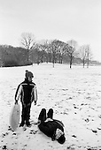 Brooklyn, New York<br /> USA<br /> December 20, 2009<br /> <br /> Oxanna Suau and her friend Thalya Frazer, both 9 years old, sled in Prospect Park.