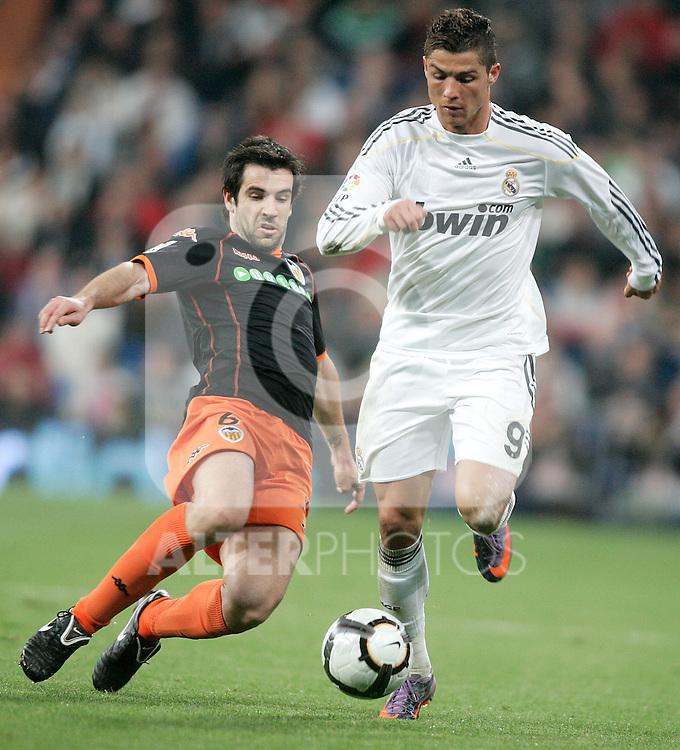 Real Madrid's Cristiano Ronaldo against Valencia's David Albelda during La Liga match, April 18, 2010. (ALTERPHOTOS/Alvaro Hernandez).
