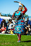 RANDALL'S ISLAND ISLAND, MANHATTEN - October 10, 2016:  A jingle dancer performs at Monday's Indigneous Peoples Day Celebration.